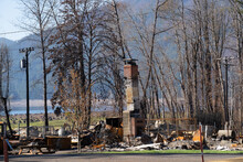 The Beachie Creek Wildfire Totally Destroyed This Home In Detroit Oregon; Only The Chimney Remains, With Detroit Lake In Background