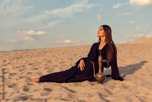 Fototapeta Muslim girl in the summer desert obraz