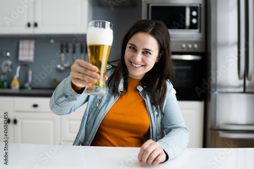 Woman Drinking Beverage Beer In Video Conference © Andrey Popov