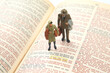 miniature people. woman and man stand on the bible text. search for the path of life. I am the way.
