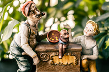 Small Old Ornament By Unknown Author From An Old Man, A Boy And A Circus Monkey In A Musical Carriage.