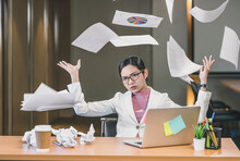 Asian Businesswoman Angry Throwing Papers Over The Herself In Office When Job Fail, Unsuccessful Project, Work Hard And Overworked And Stressed Concept,