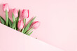 Beautiful pink tulips on pastel pink background. Concept Women's Day, March 8. 8th march. Flat lay, top view, copy space