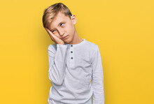 Little Caucasian Boy Kid Wearing Casual Clothes Thinking Looking Tired And Bored With Depression Problems With Crossed Arms.