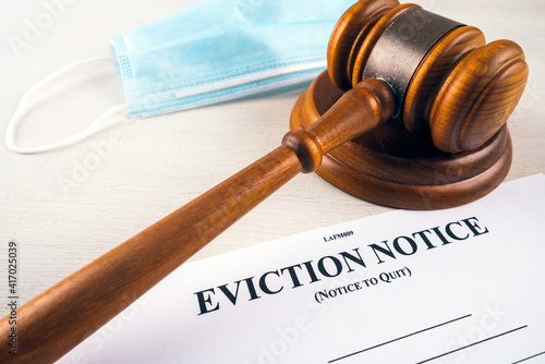 Canvastavla Eviction notice, notice to quit document with facial mask and gavel during covid-19