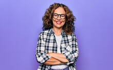 Middle Age Beautiful Woman Wearing Casual Shirt And Glasses Over Isolated Purple Background Happy Face Smiling With Crossed Arms Looking At The Camera. Positive Person.