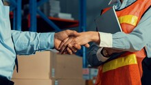 Warehouse Worker Handshake With Manager In Storehouse . Logistics , Supply Chain And Warehouse Business Concept .