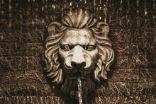 Lion Head Fountain On A Stone Wall