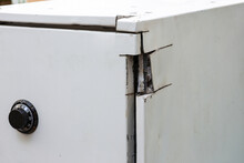 Broken A Sentry Safe. Unsuccessful Attempt To Break Into The Safe. Thieves Could Not Pick The Lock And Break Down The Door Of The Bank Safe
