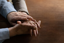 Senior Mature Man Holding Hand Of Beloved Middle Aged Wife. Old Family Couple Enjoys Time Together, Expressing Love, Affection And Support. Close Up Of Arms With Wedding Ring. OAP Relationship Concept