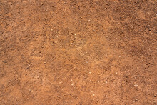 Dirt, Terrain Or Gravel Stone Road Surface Pattern In Outdoor Environmental. Background And Textured Photo.
