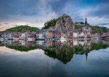 Scenic View Of The Belgian Town Dinant Reflected In The River Meuse