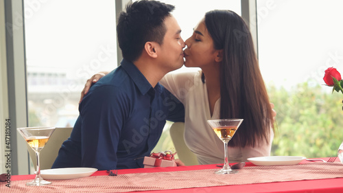 Happy romantic couple eating lunch at restaurant . Couple anniversary celebration and lifestyle . © Blue Planet Studio
