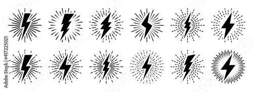 Fotografía Set of vintage lightning bolts and sun rays isolated on white background