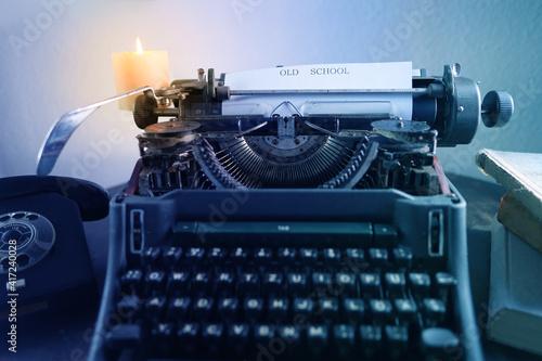 Billede på lærred typewriter on table, words fake news are printed on paper in large size, candle