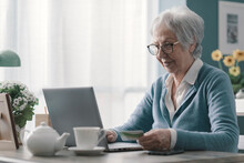 Senior Woman Using A Credit Card Online