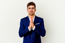 Young Business Caucasian Man Isolated On White Background Praying, Showing Devotion, Religious Person Looking For Divine Inspiration.