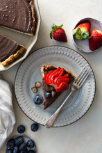 Slice Of Chocloate Cheesecake With Strawberries And Blueberries, Top View.
