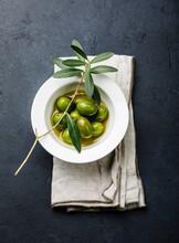 Olives, Olive Oil And Olive Branch On Black Dark Background