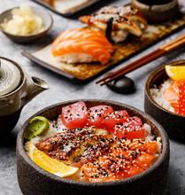 Sushi Set And Sashimi Rice Bowl With Tuna And Salmon On Gray Table
