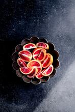 Blood Oranges Sliced In A Bowl