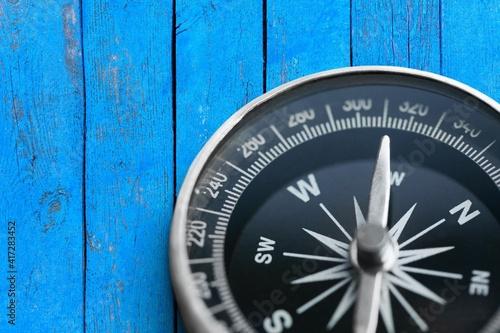 Brass antique classical compass on wooden desk © BillionPhotos.com
