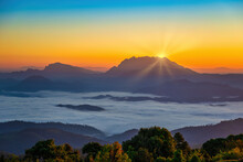 Tropical Forest Nature Landscape View With Mountain Range Sunrise With Moving Cloud Mist At Huai Nam Dang National Park, Chiang Mai Thailand