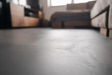 Low Angle Indoor Shot Of Livingroom With Closeup Focus On Floor