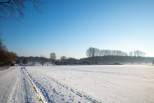 Outdoor Sunny View Of Thick Layer Snow Cover Street, Land And Field In Countryside In Germany During Winter Season.