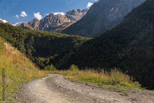 Picturesque mountain landscape with river and peaks on a sunny day. Caucasus Mountains. National Park North Ossetia - Alania