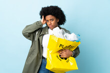 Young African American Woman Holding A Recycle Bag Isolated On Colorful Background With An Expression Of Frustration And Not Understanding