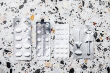 Various Pills On Mottled Background