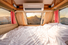 Mattress In Camper Van And Beautiful Landscape While Road Trip Traveling On Vacation