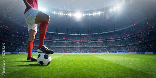 Photo Football player in the stadium