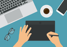 Flat Design Illustration Of Hand Graphic Drawing On Digital Tablet. Laptop Keyboard With Glasses And Mobile Phone. Cup Of Coffee On The Work Table, Vector