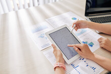 Hands Of Business People Pointing At Chart On Tablet Computer When Working On Financial Strategy