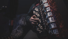 Close Up A Man Plays The Accordion In The Studio.