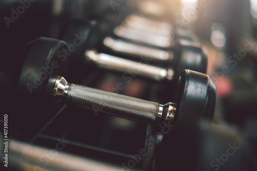 Close up of dumbbells placed at the gym.