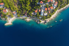 Famous Adriatic Coast. Panoramic Aerial View Of Picturesque Coastline In Makarska Riviera, Brela, Croatia, Europe. Top View On Splendid Adriatic Sea And A Village By The Sea. Copy Space, Postcard.