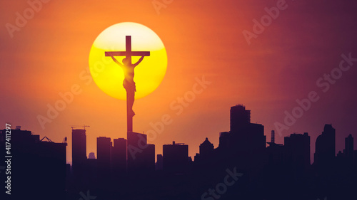 Fotografering Christian cross with silhouette of skyscrapers