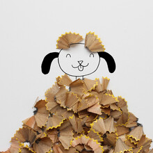 Conceptual Dog In A  Pile Of Autumn Leaves