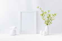 Home Interior With Easter Decor. Mockup With A White Frame And Spring Flowers In A Vase On A Light Background
