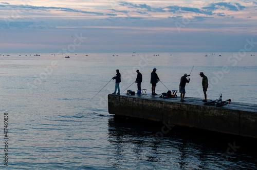 Fototapeta Ships on horizon stand in roadstead