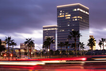 Twilight Evening View Of Traffic Streaming By The Downtown Skyline Of Irvine, California, USA.