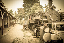 An Aged Photo Of A 20th Century Steam Engine Locomotive Train Waiting At The Station Primarily For Visitors