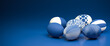 Leinwanddruck Bild - Easter Eggs with different textures in classic blue on a seamless blue background. Web banner format