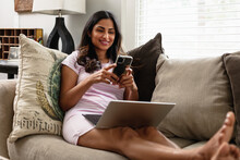 Indian American Woman Works From Home Remotely On Laptop, Telework