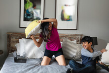 Indian Mom And Son Playing Around At Home, Pillow Fight, Fun Moment