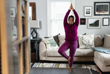 Black Woman Does Tree Yoga Pose, At Home Fitness And Wellness, Centered Strength