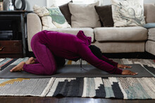 Black Woman Doing Childs Pose At Home In Living Room, Yoga Flow